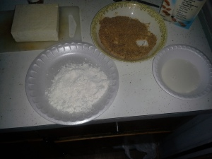 Cut Tofu into about 8 Pieces Flour is optional. I dip in flour before I dip in milk and breadcrumb mixture.